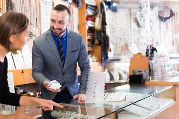 man offering bracelets in the shop
