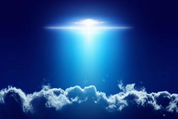 Poster UFO Extraterrestrial aliens spaceship, ufo with bright spotlight in dark blue sky