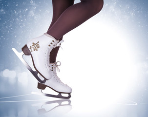 Woman legs in ice skating boots
