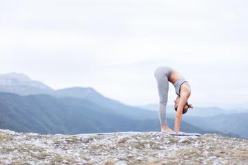 Female practicing morning yoga and sun salutation