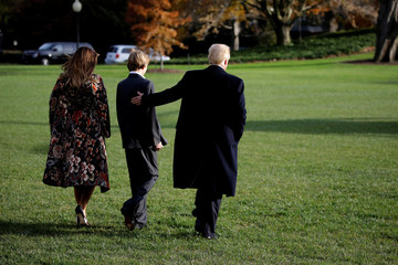 U.S. President Donald Trump, First Lady Melania Trump and their son Barron depart the White House for Palm Beach, in Washington D.C.