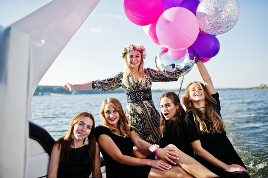Girls having fun at yacht on hen party.
