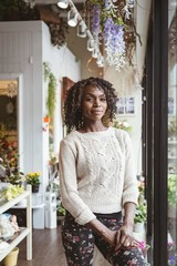 Female florist standing at flower shop