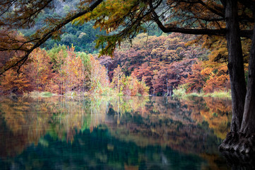 Autumn Reflections on the Frio River in Garner State Park, Texas