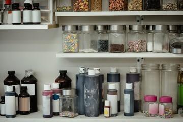 Various ingredient bottles kept in shelf