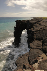 Holei Sea Arch at the end of Chain of Craters road on the Big Island of Hawaii in late afternoon light