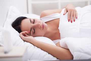 Young beautiful woman sleeps in the bedroom. Close-up.