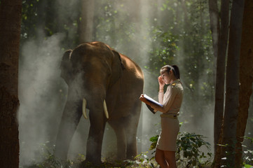 Beautiful teacher woman and elephant,vintage style,Thailand