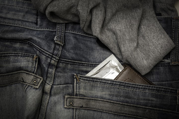 Condom in package in jeans