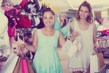 Female customers in underwear shop