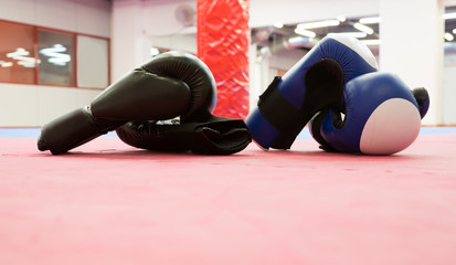 Boxing gloves laying in gym