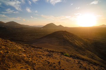 A stunning view of the volcanic landscape from the crater of the volcano El Cuervo. Lanzarote. Canary Islands. Spain