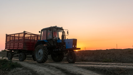 Farm tractor with a trailer