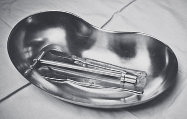 Emergency medical care. Metal tray and old surgical instruments