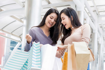 Beautiful young Asian woman friends enjoying shopping in the city