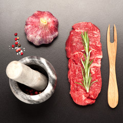 Fototapete - raw steak Ribeye entrecote on black stone background