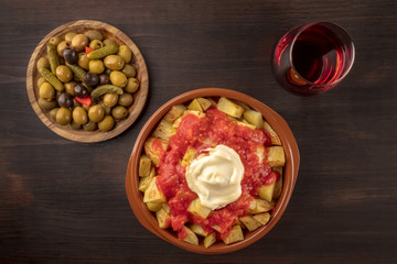 Tapas and wine. Patatas bravas, olives, and copy space