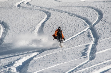Active snowboarder riding on the mountain slope