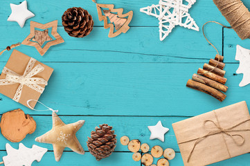 Christmas mock up with place for your text and white christmas tree and star gift, cone on a turquoise wooden background. Flat lay, top view photo mockup