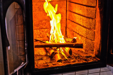 A bright fire burns in the fireplace
