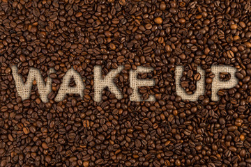 Wake up concept written on coffee beans