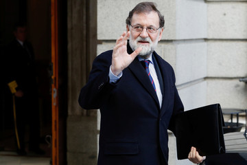 Spain's Prime Minister Mariano Rajoy waves as he leaves parliament in Madrid