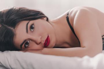 beautiful girl lying on bed