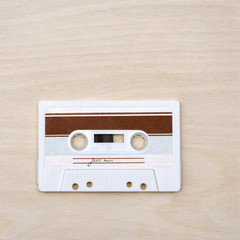 Vintage audio cassette tape with jazz music on wooden background