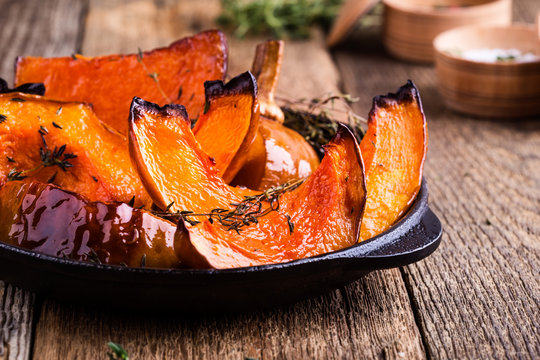 Baked pumpkin with thyme in cast iron skillet