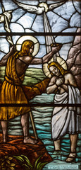 Casorate Primo, Italy. October 26 2017. Stained glass depicting the baptism of Jesus Christ by John the Baptist. San Vittore Martire Church (Church of Saint Victor Maurus or the Moor the martyr)