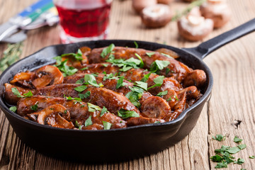 Sausages with onion and mushrooms gravy
