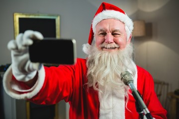 Santa claus taking selfie from mobile phone