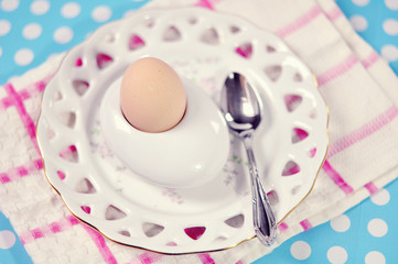 Boiled egg on egg holder on table