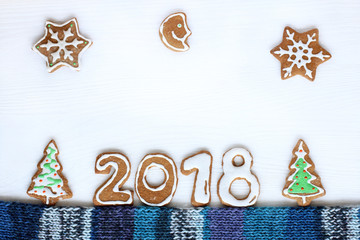 sweet new 2018 year/ installation from a festive, figured cookie on a light surface top view