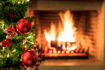 Christmas tree on burning fireplace background