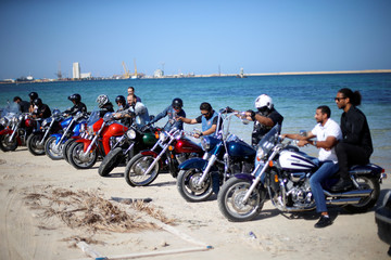Members of Tripoli bikers group ride their motorbikes at the beach in Tripoli