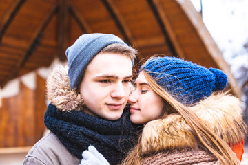 Couple in love walking in winter park and enjoy each other's company
