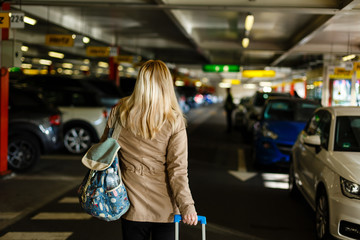 Young woman with travel bag and walking at the parking airport ready for travel. concept. lifestyle