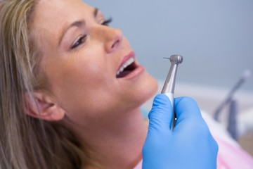 Cropped image of dentist holding medical equipment while giving