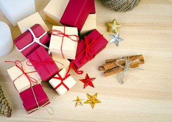 Red and beige gift box and Christmas decoration on wooden background