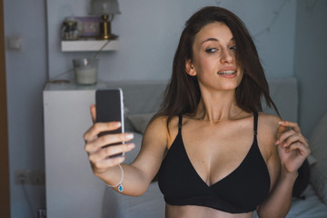 Woman in bra taking selfie