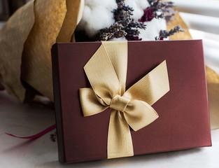 Terra cotta present box with gold ribbon