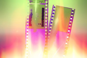 Vintage film strip background with fire and flames effect.
