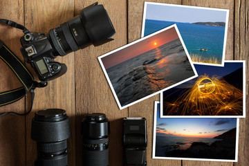 DSLR digital camera,lens,flash and stack of photos on vintage grunge wooden background, photography hobby holiday concept