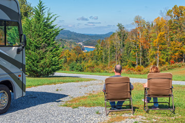 RV Couple Enjoying The View From Their Campsite