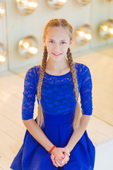 portrait girl with two pigtails