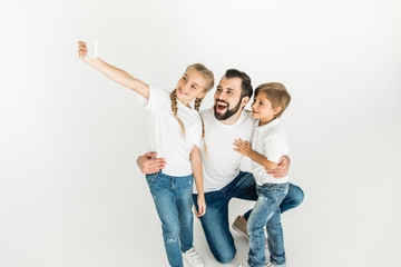 father with kids taking selfie