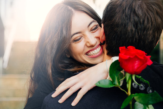 Happy couple in love with a rose