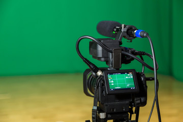 Digital camera in a television Studio. Filming on green screen chroma key.