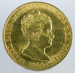 Ancient Spanish gold coin of Queen Isabel II. With a value of 80 reales and minted in Barcelona. 1844. Obverse.